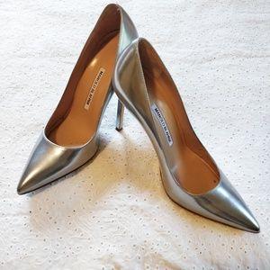 Matte silver Manolo Blahnik point toe pump heels.